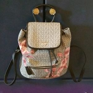 A medium sized Guess backpack purse